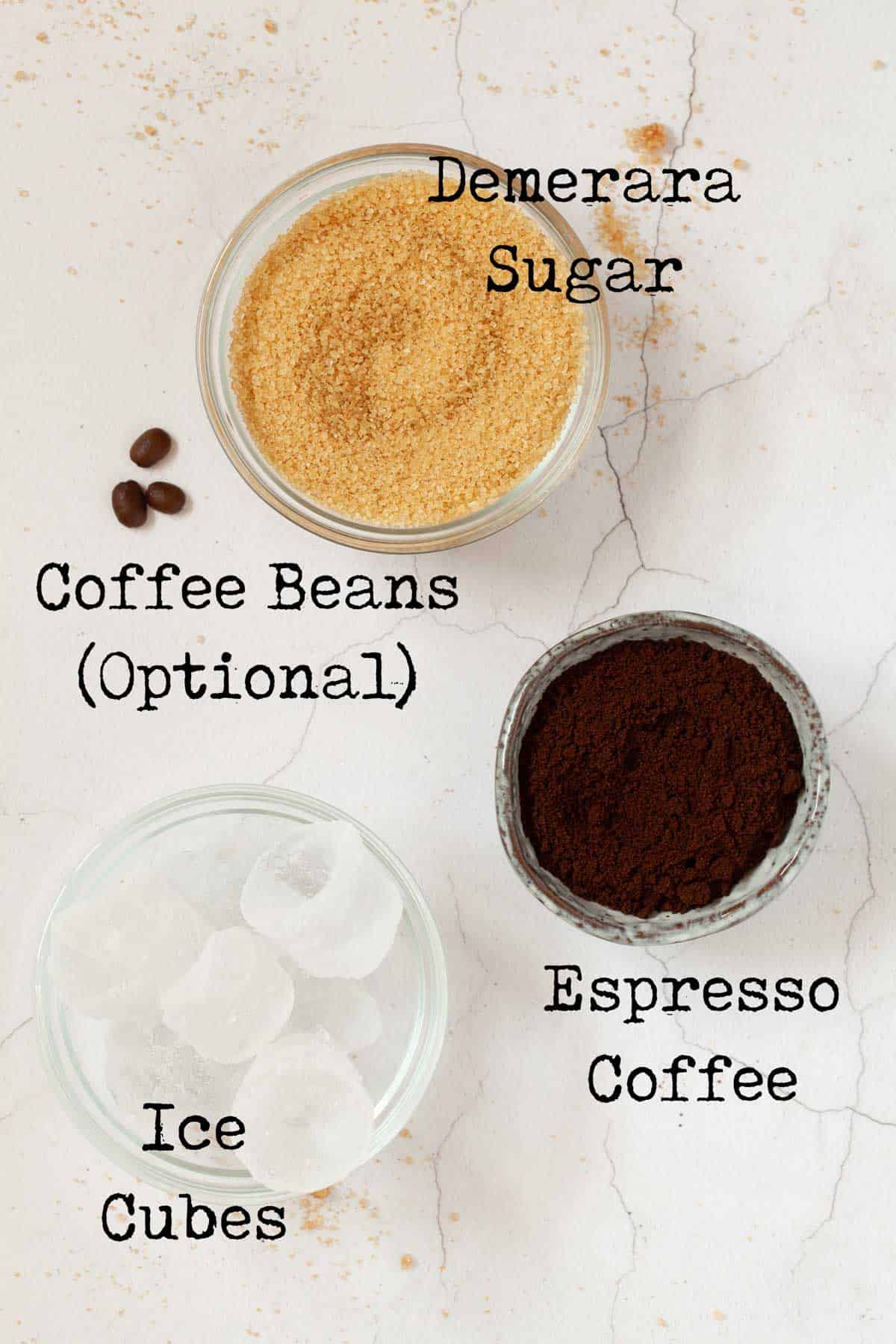 Ingredients for iced coffee: ground coffee, ice, sugar, coffee beans