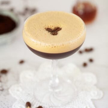 caffè shakerato (Italian iced coffee) garnished with coffee beans