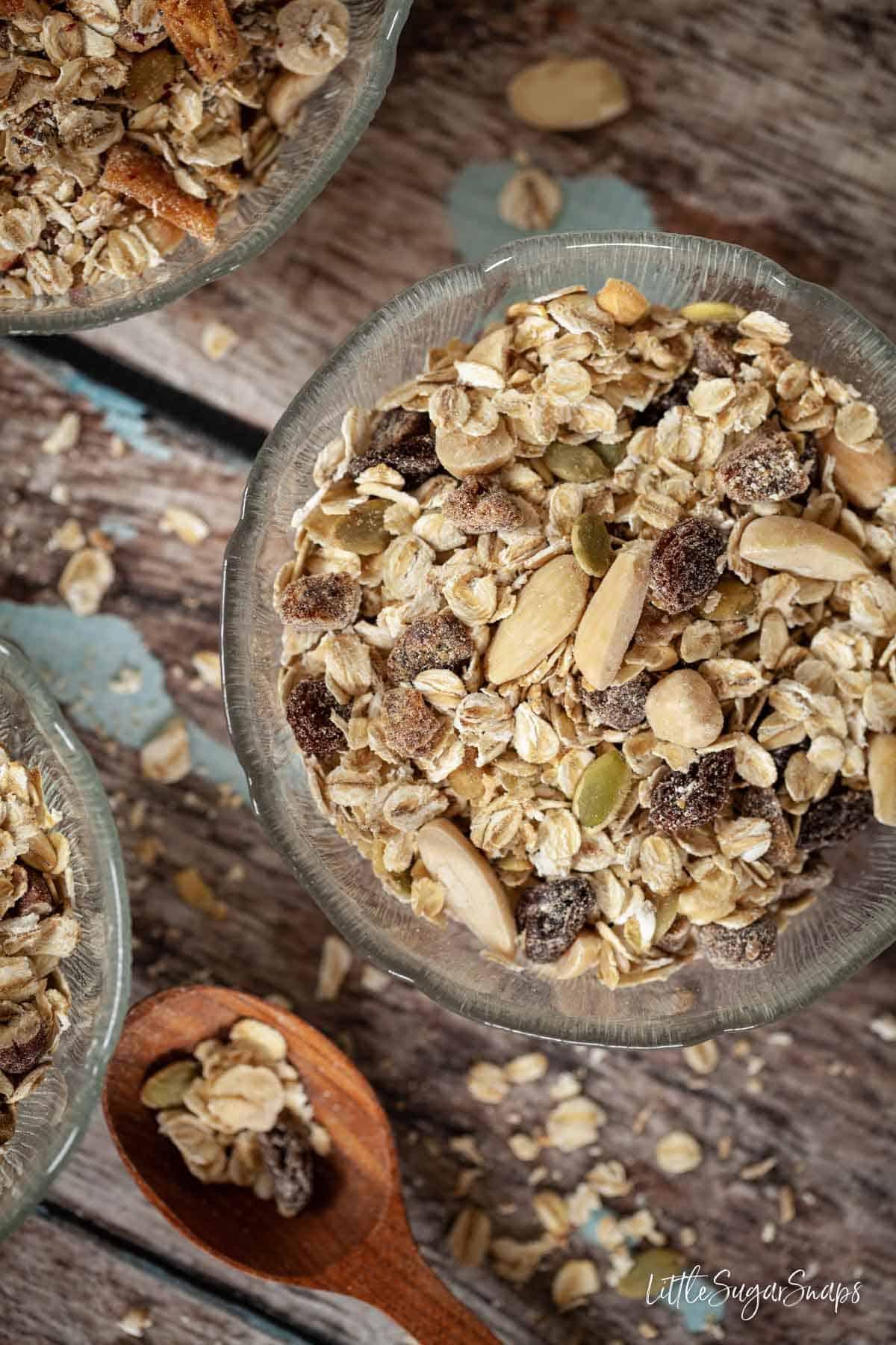 Bowls of homemade muesli with dates, raisins, almonds and hazelnuts