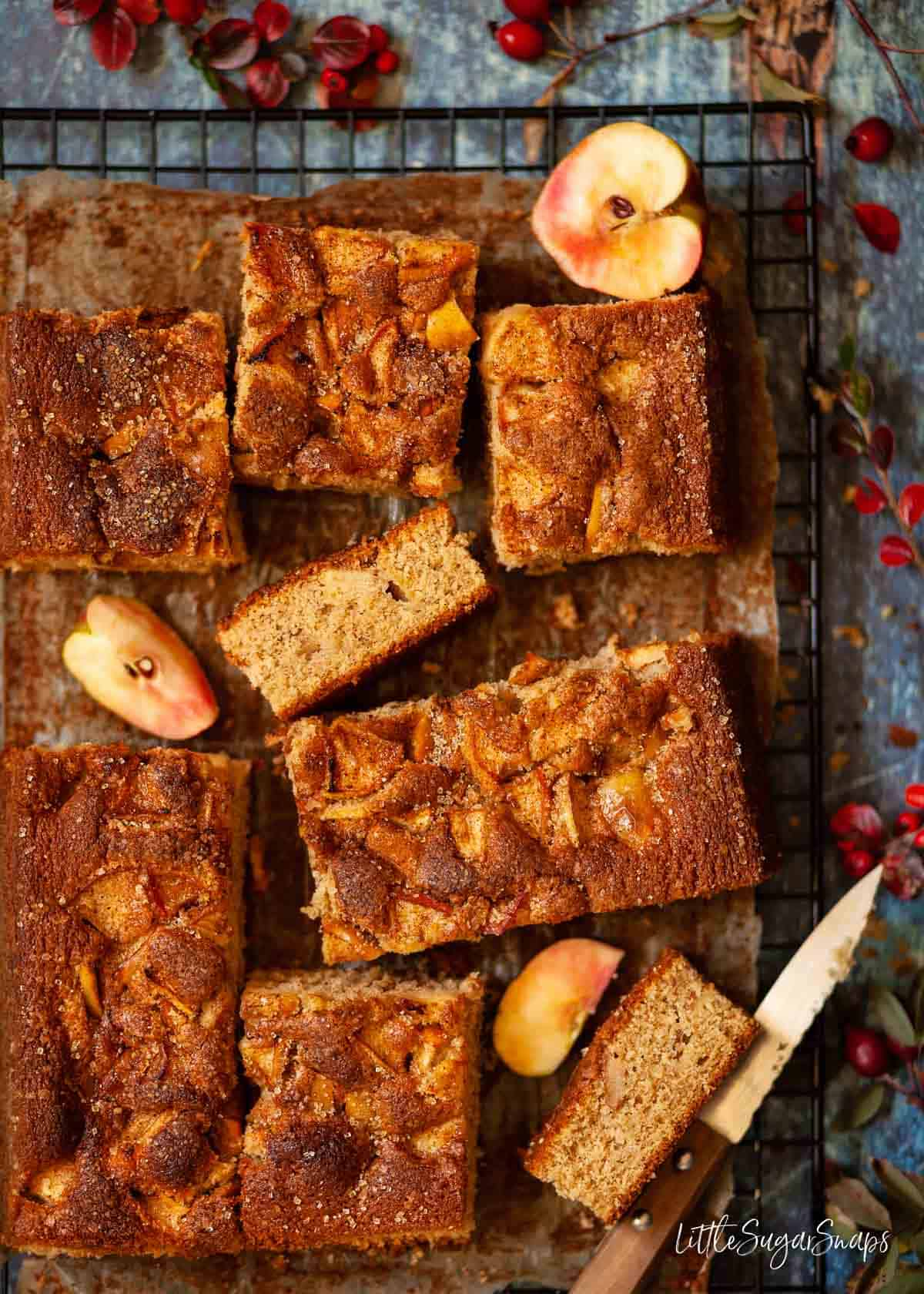Spiced Apple traybake cake cut into pieces on a wire rack