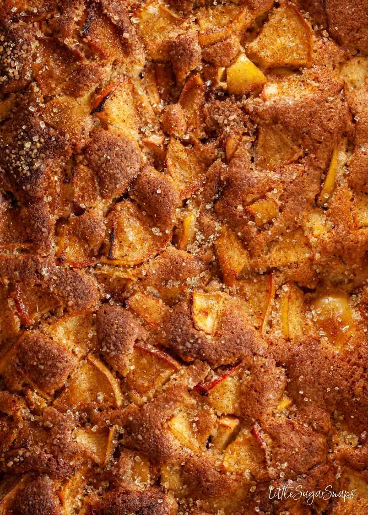 Close up of the top of an apple cake once baked