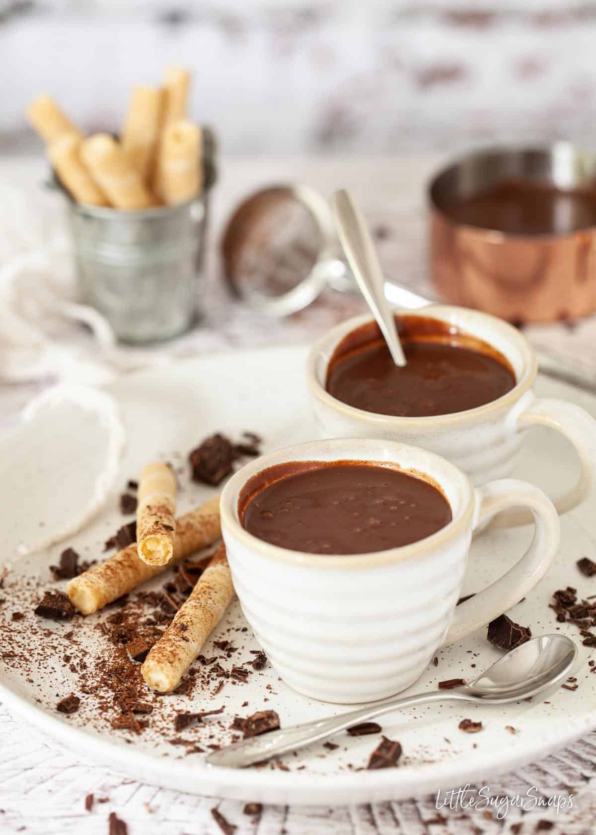 Cups of thick Italian hot chocolate served with wafers for dipping