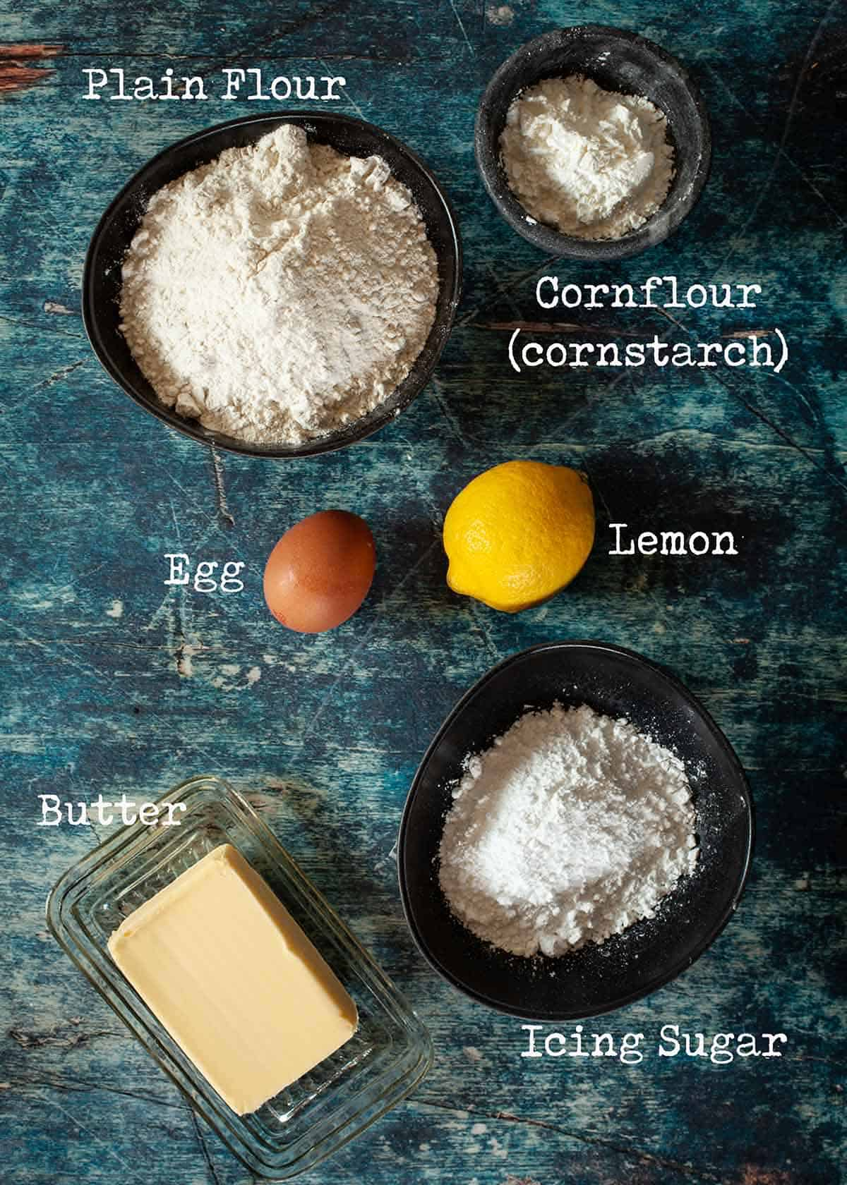 Ingredients for lemon shortbread cookies with text overlay