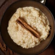 A bowl of stovetop rice pudding topped with cinnamon