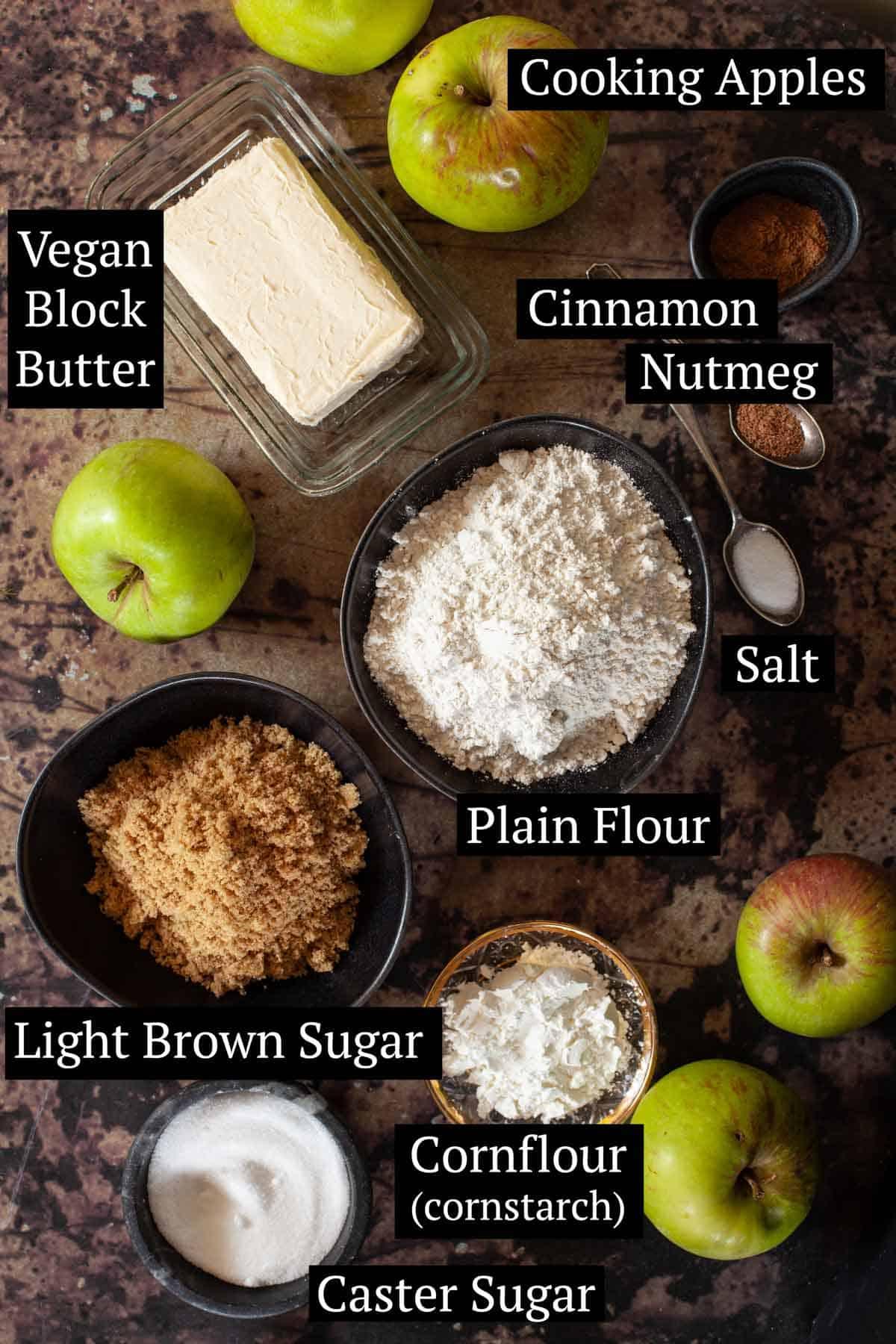 Ingredients for vegan apple pie in bowls
