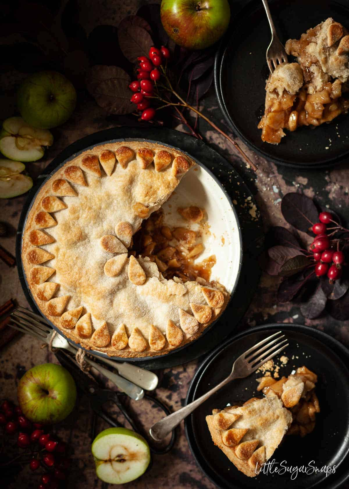 Vegan apple pie in a tin with several slices removed