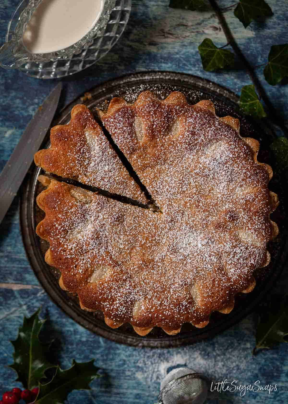 A family sized frangipane mince pie with a slice cut