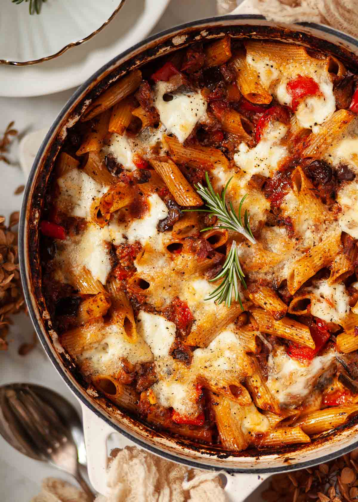A cooked aubergine pasta bake in a large overproof pot