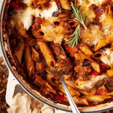 A pan of pasta al forno with aubergine ragu