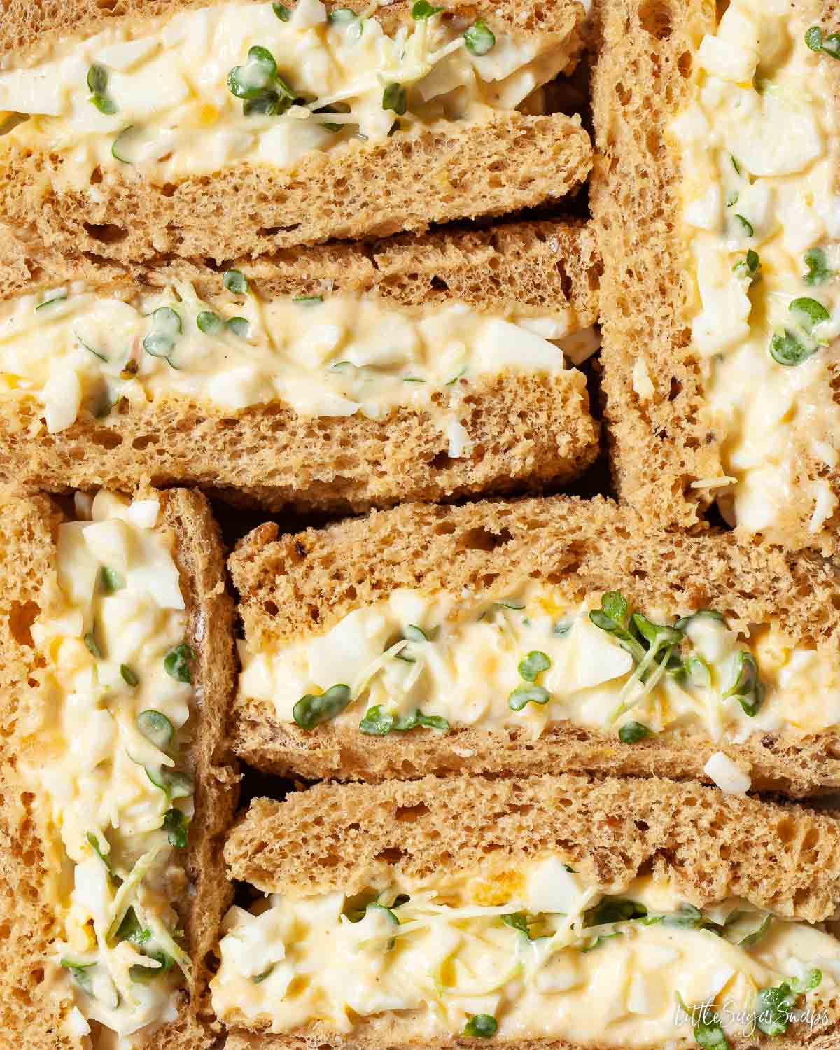 Close up of egg mayo sandwiches made on brown bread