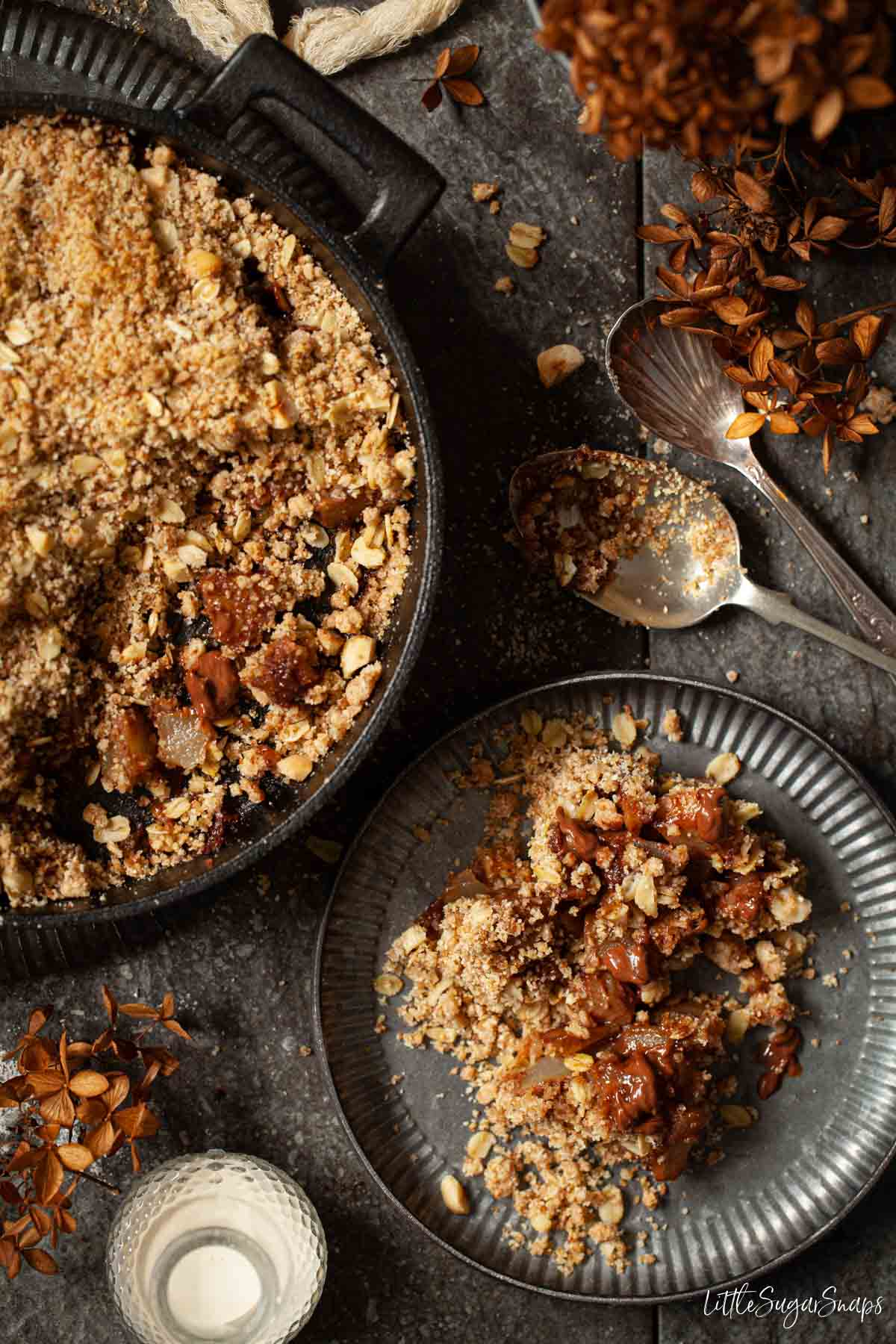 Chocolate and Pear crumble being served from a skillet onto plates