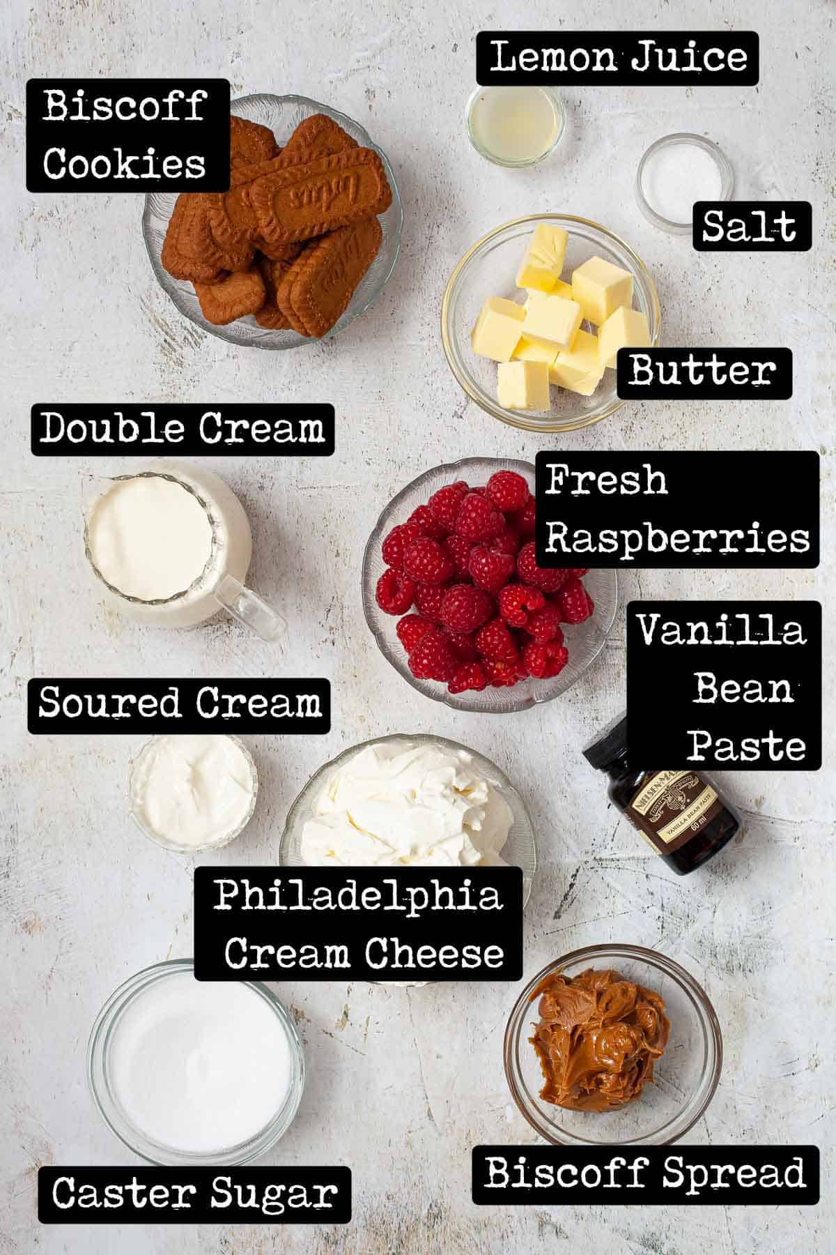 Ingredients in bowls with text overlay for a recipe using cookies, cream cheese and raspberries