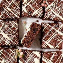 Chocolate flajack squares with one on its side to reveal the inside