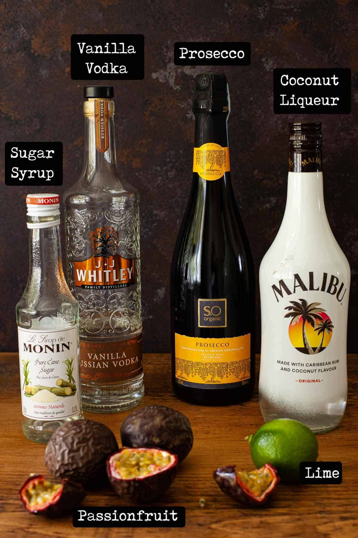 Bottles of alcohol and fruit with text overlay - ingredients for a cocktail