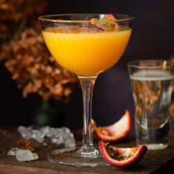 A tropical passionfruit martini with a small glass of Prosecco