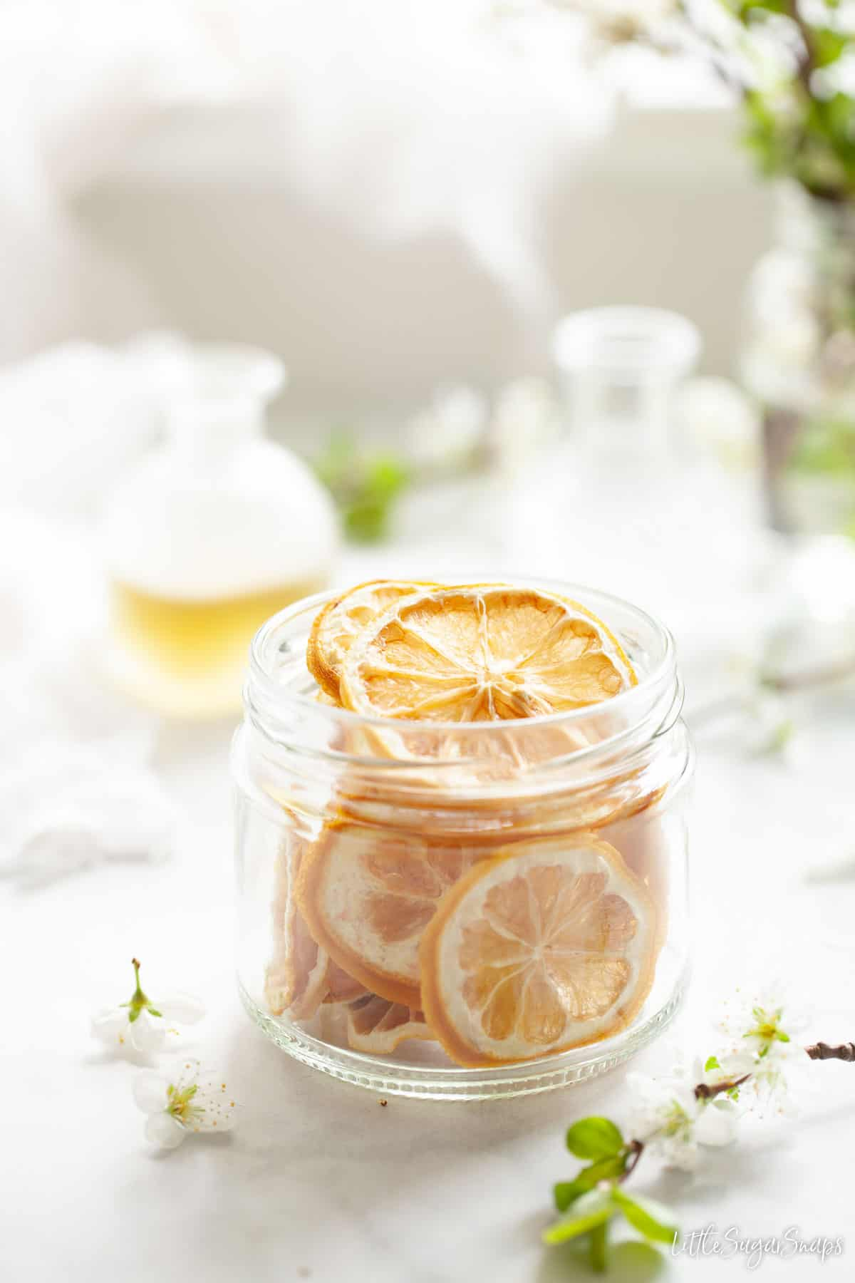 A jar of dehydrated lemon wheels suitable for cocktail or cake garnishes