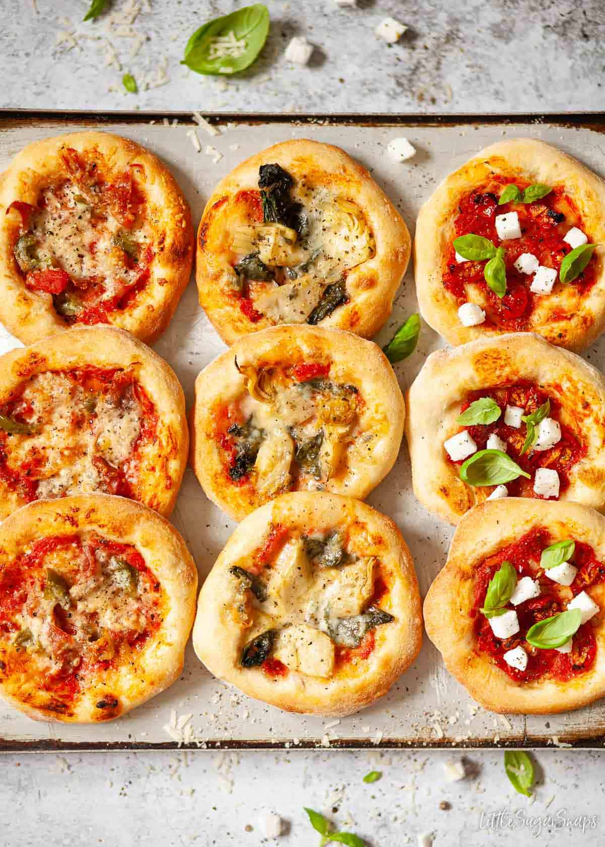 Assorted pizzette on a baking tray