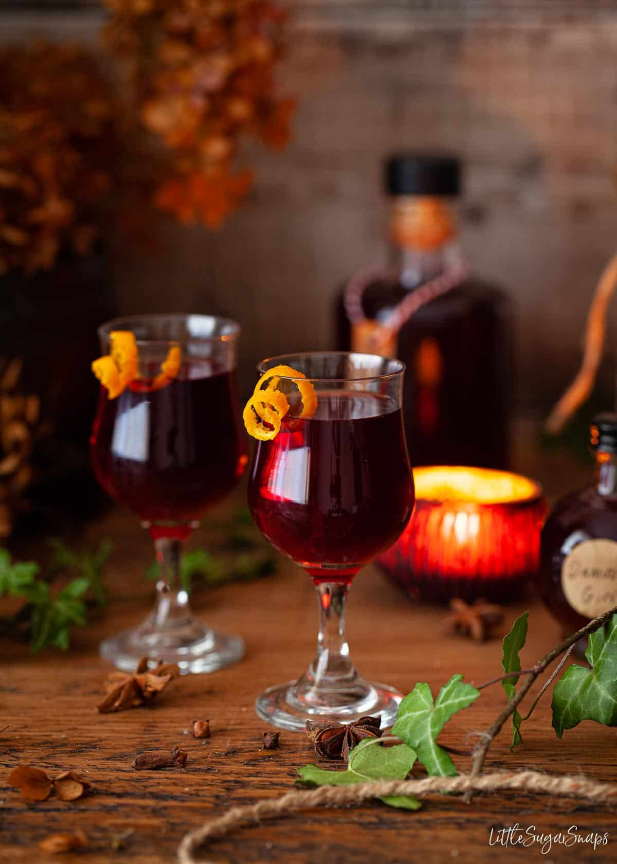 Glasses of damson gin served with a twist of orange