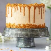 Vegan Biscoff drip cake on a stand.