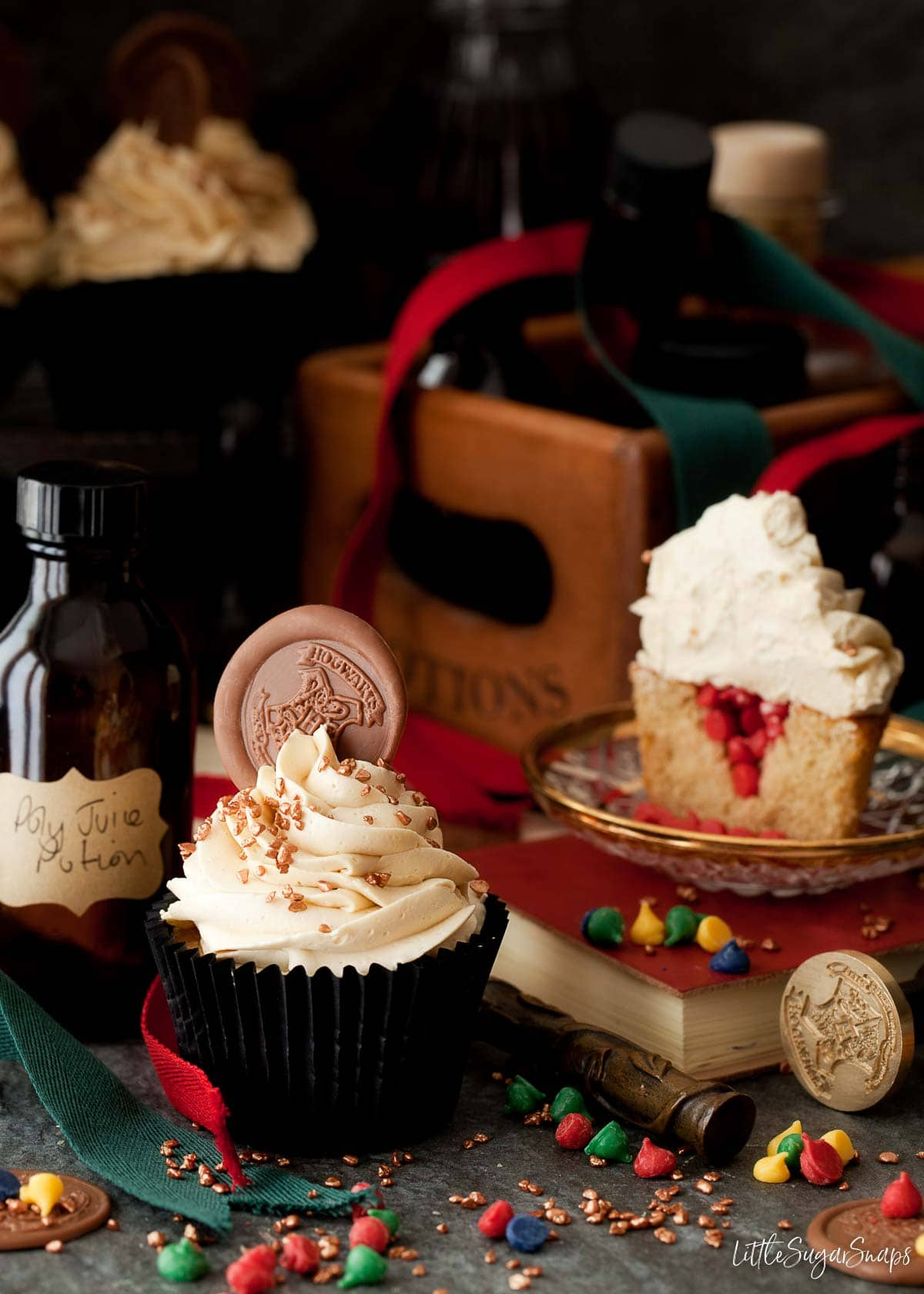 Harry potter sorting hat cupcakes with Gryffindor coloured candy drops inside